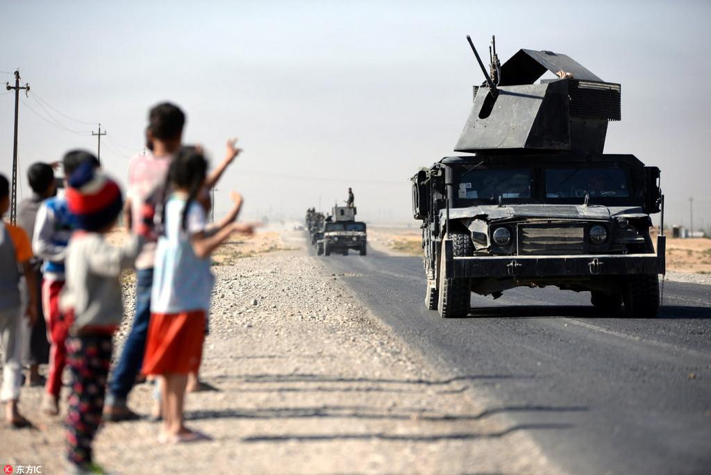 Iraqi forces capture key sites from Kurds outside Kirkuk