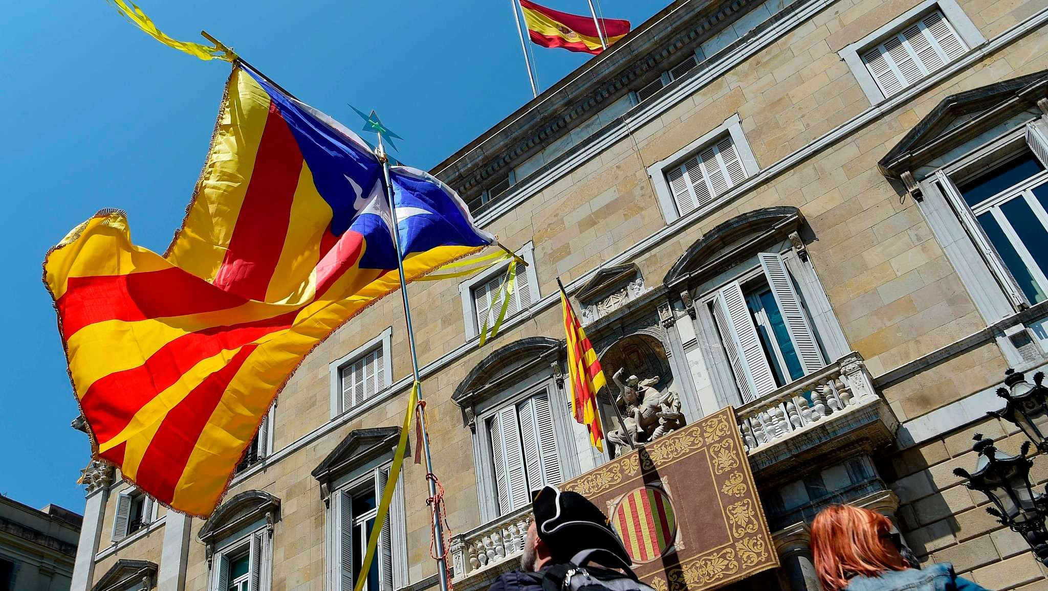 Catalonia names exiled, jailed politicians in new cabinet