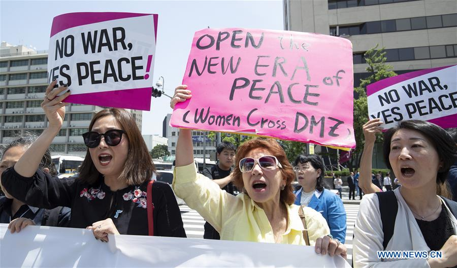 Activists rally to call for US-DPRK summit to be held as planned