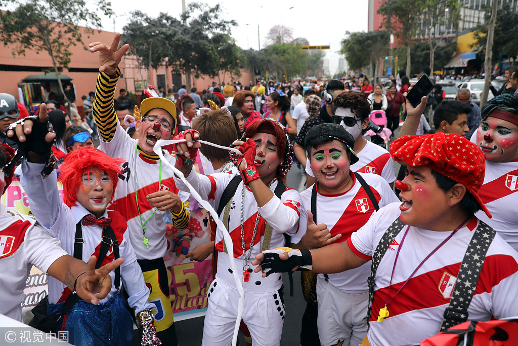 Clowns take part in a parade