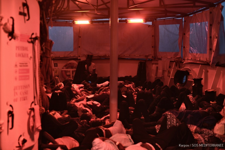 Migrants on stranded rescue ship prepare for voyage to Spain