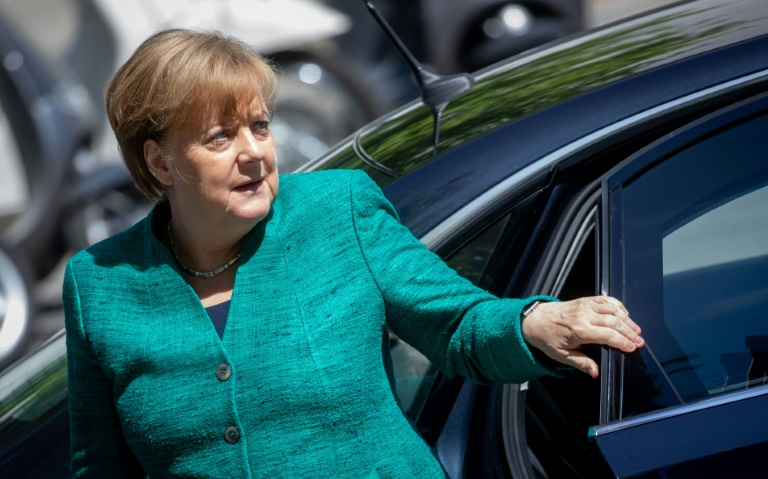 Merkel under pressure in escalating row over immigration