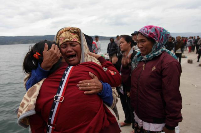 Rescuers hunt for victims of ferry disaster on Indonesian supervolcano lake