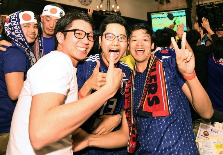 Boozy Japan fans go wild after shock World Cup win