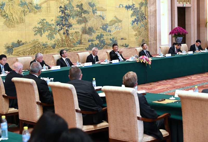 Chinese President Xi Jinping meets with executives of some famous multinational enterprises, who are in Beijing to attend a special session of round-table summit of Global CEO Council, on Thursday, June 21, 2018. [Photo: Xinhua]
