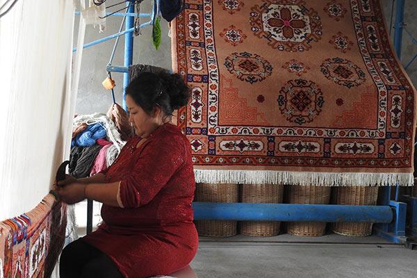 In Xinjiang, carpets retain their magic as industry grows