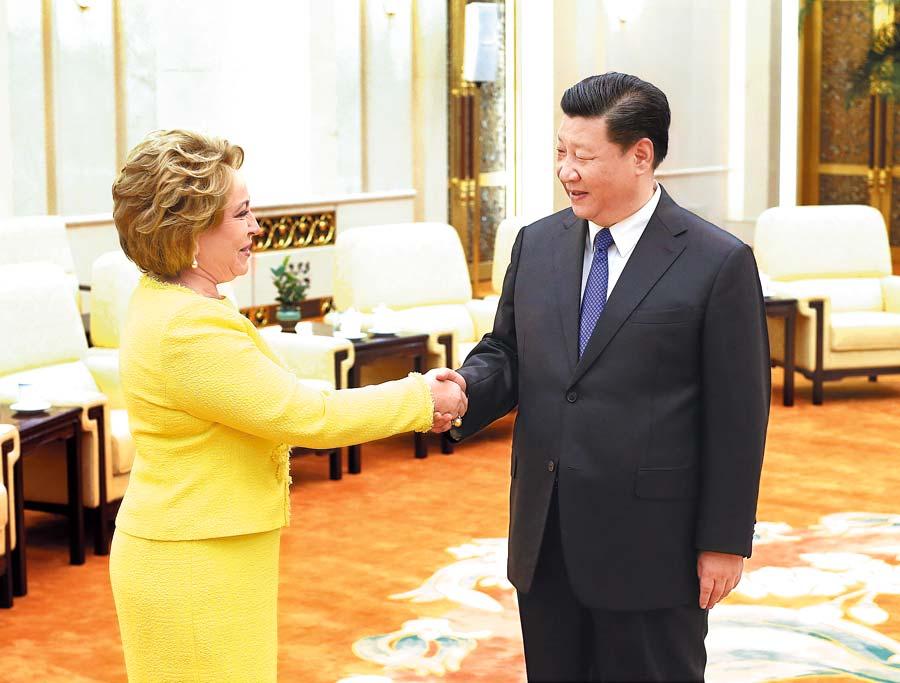 Xi: Cherish China-Russia ties