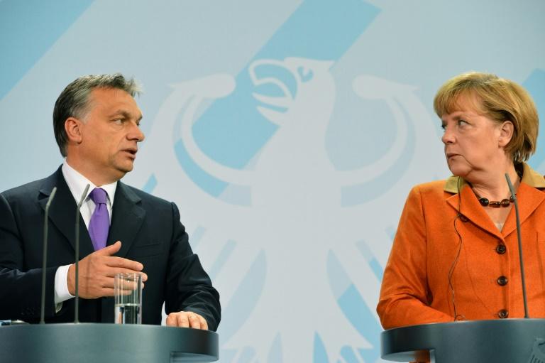Merkel, Orban clash over EU values with anti-migrant wind blowing