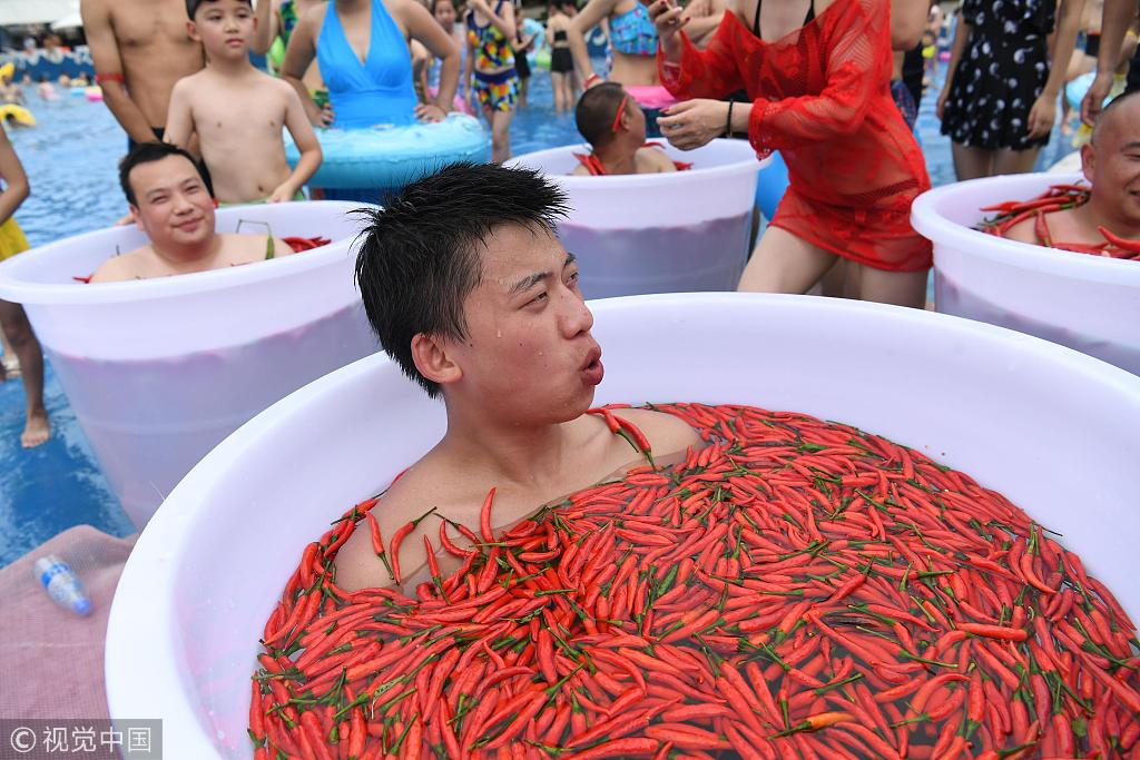 Citizens take on the Hot Bucket Challenge to beat the heat in Chongqing