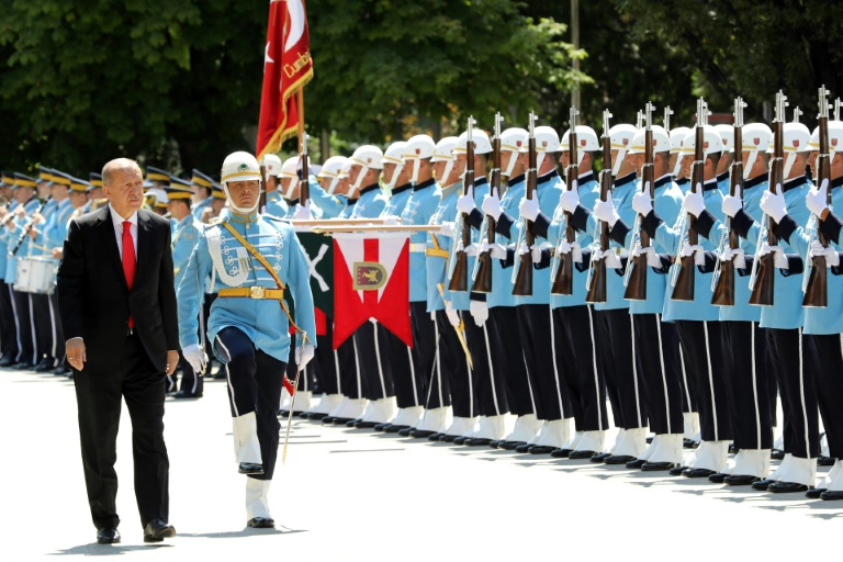 Turkey's Erdogan begins new term with expanded powers