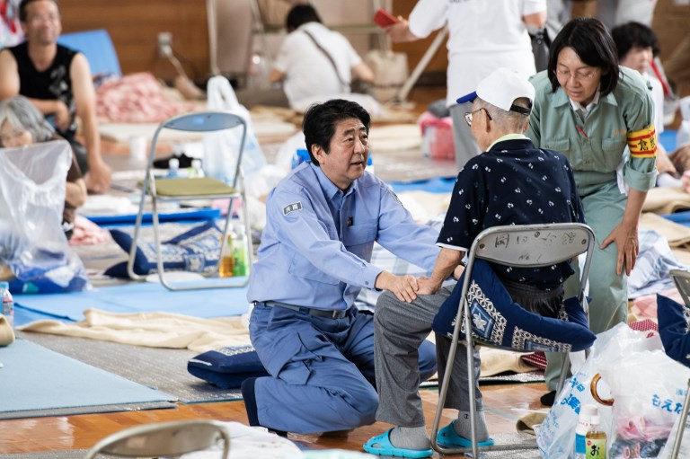 Japan PM meets stranded evacuees in flood disaster zone
