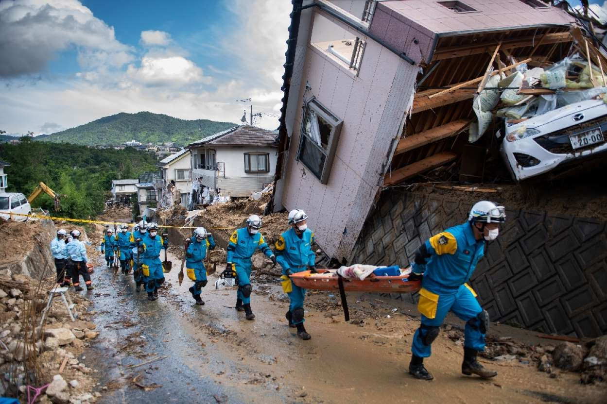 Japan PM meets rain disaster survivors, pledges more aid