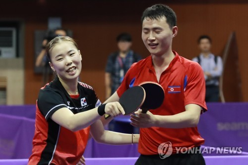 Unified table tennis team of S. Korea, N. Korea wins 1st victory in preliminary of int'l event