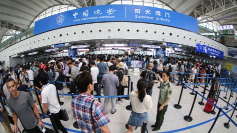 China sees 310 mln exits, entries in first half of 2018
