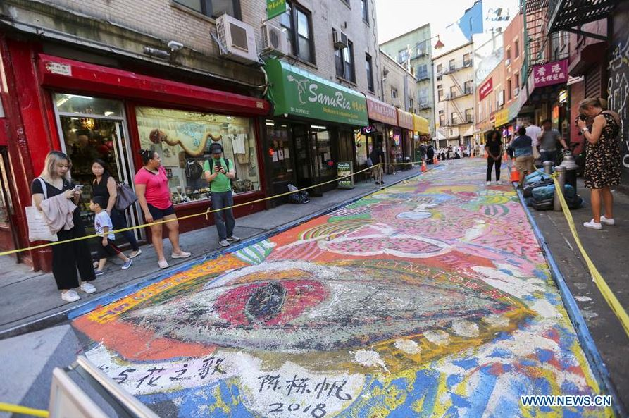 Historic street in NYC's Chinatown being painted into giant mural of dragon