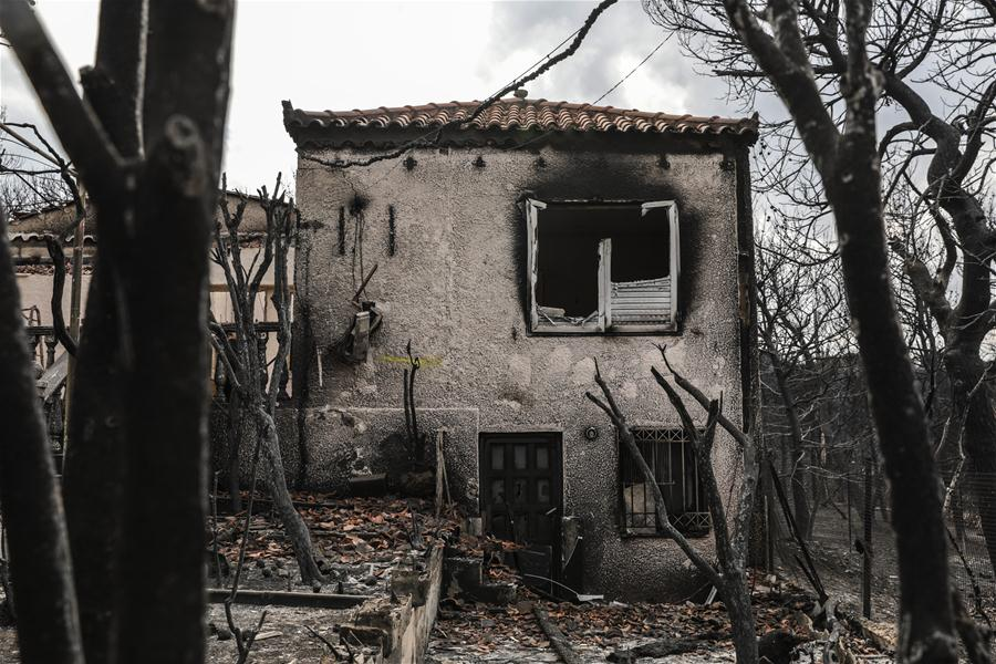 Greek authorities pledge full support to fire-stricken areas, as country mourns 74 casualties