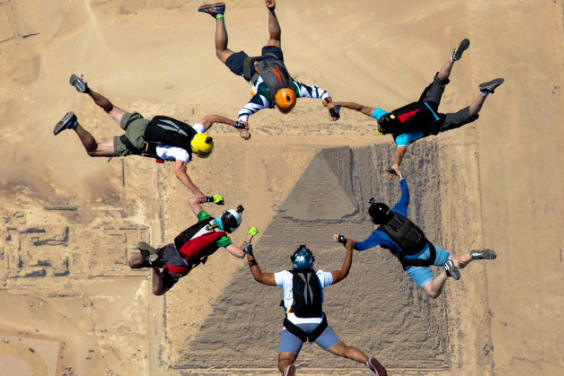 Skydivers hurtle down towards the Great Pyramid of Giza