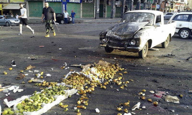 Death toll in devastating IS attacks in Syria climbs to 216