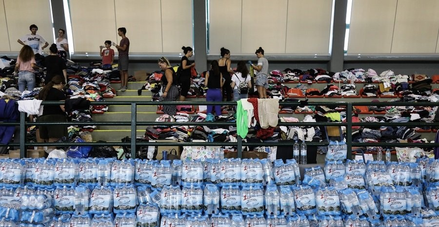 Volunteers rush in to help heal wounds of Greece's fire-stricken region