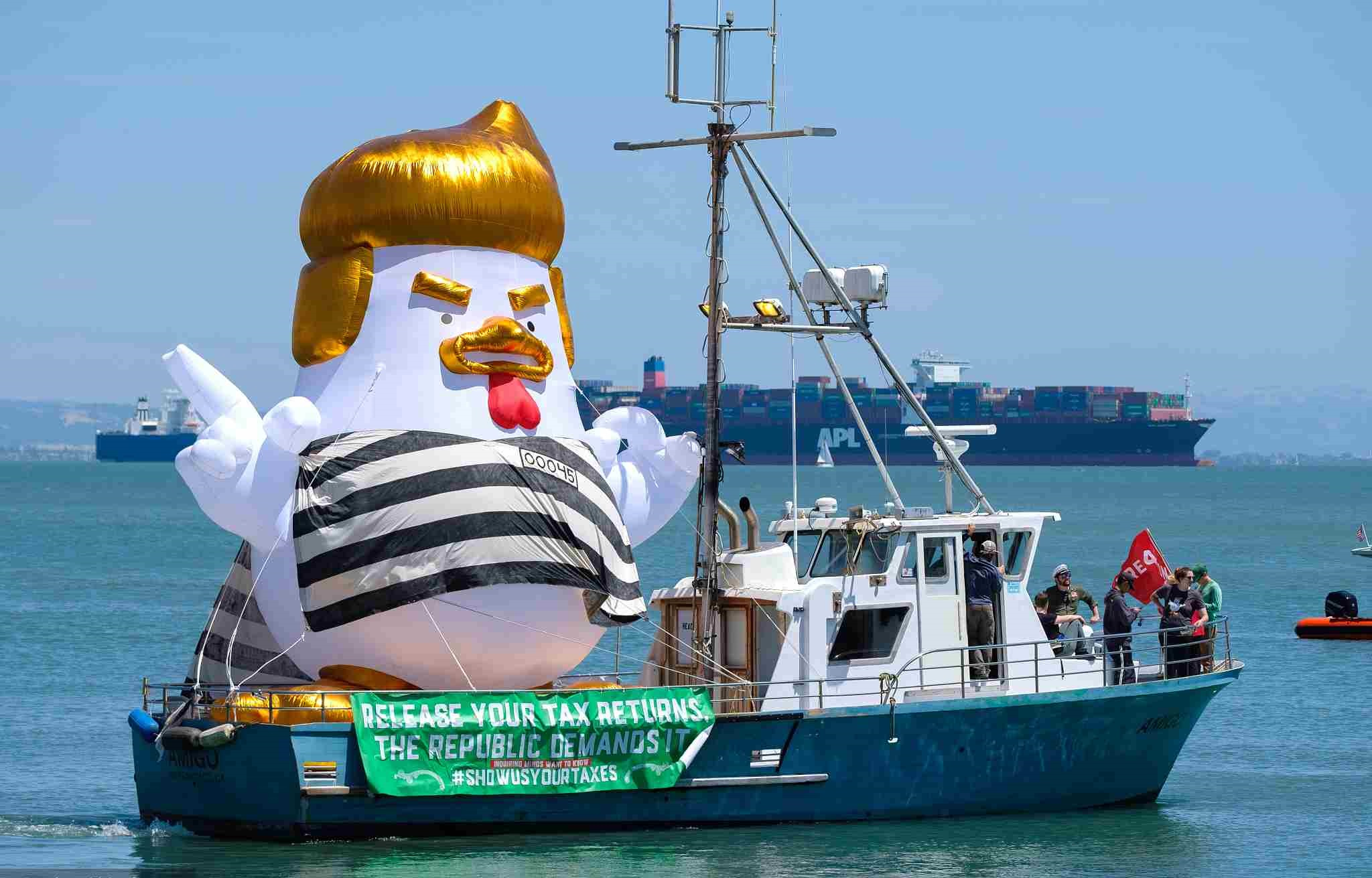 A gigantic inflatable 'Trump Chicken' donning a prison uniform sets sail from San Francisco Bay