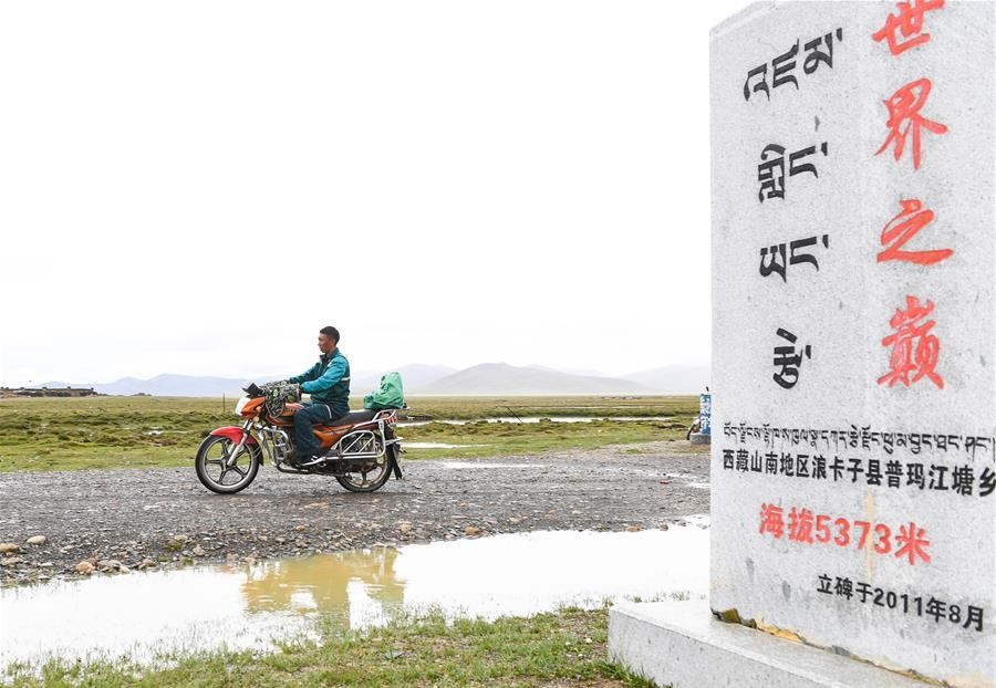 Postal service staff perform delivery task in China's highest township in Tibet