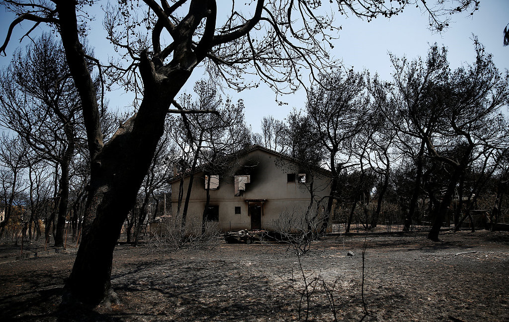Greek seaside town remembers lives lost to wildfire