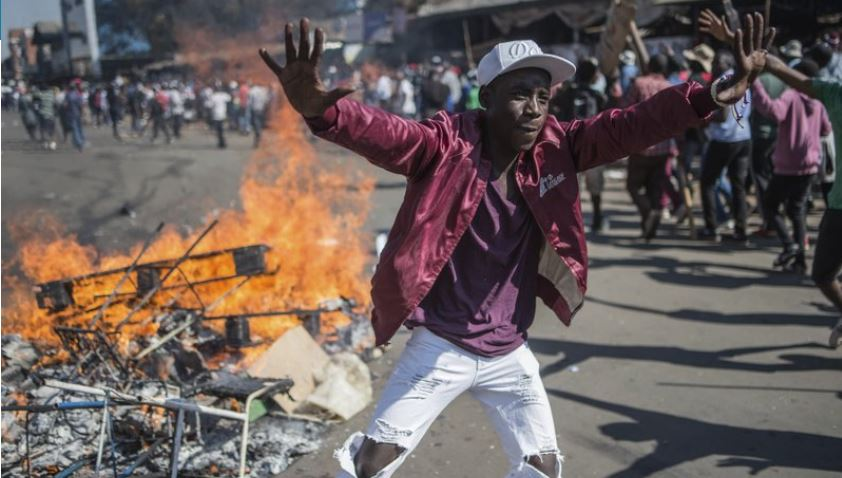 Zimbabwe's president blames opposition for chaos