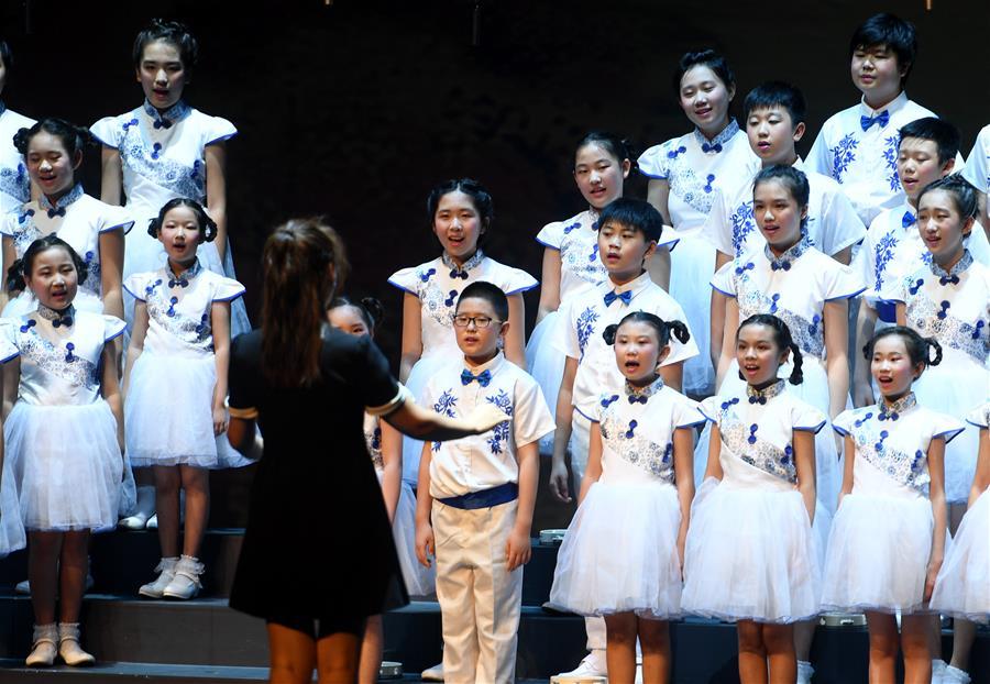 Children sing poems during public performance in Beijing