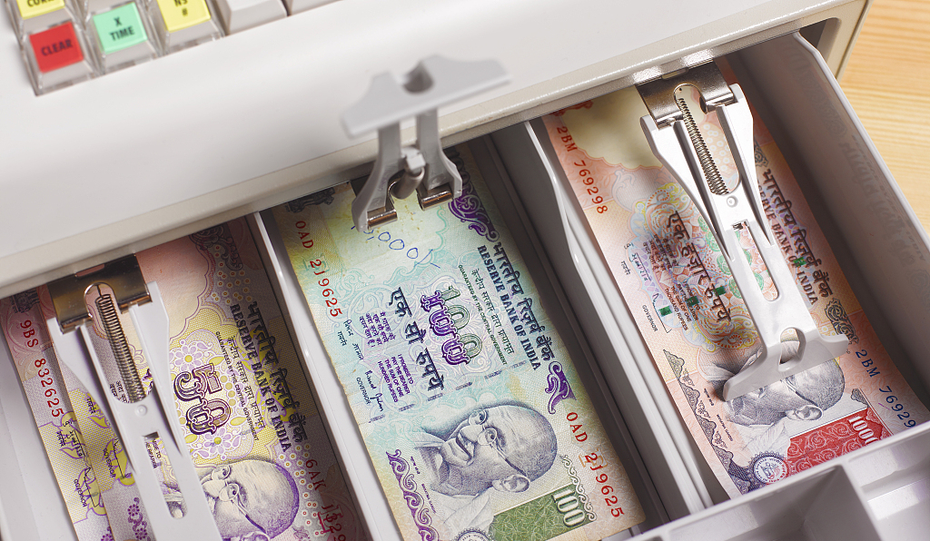 Indian rupee hits record low of 70 to the dollar