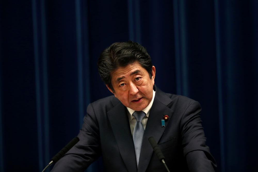 Japan's Abe sends ritual donation to notorious Yasukuni Shrine on war anniversary