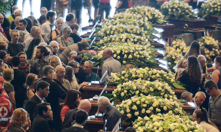Italy mourns bridge collapse victims, new emergency funds approved