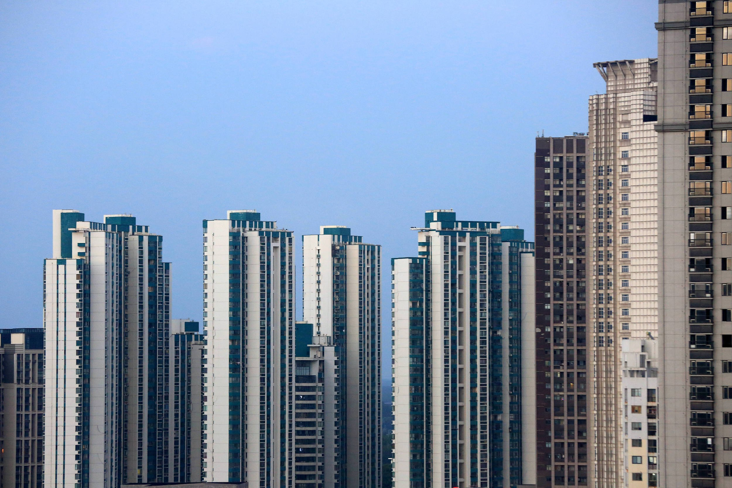 China rolls out 200 policies in H1 to cool housing market