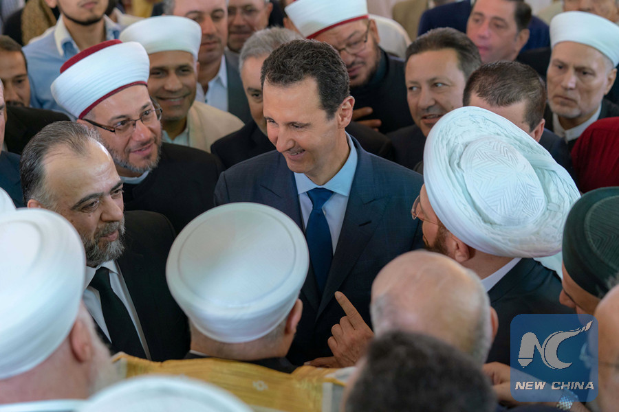 Syria's Assad performs special Eid al-Adha prayer in Damascus