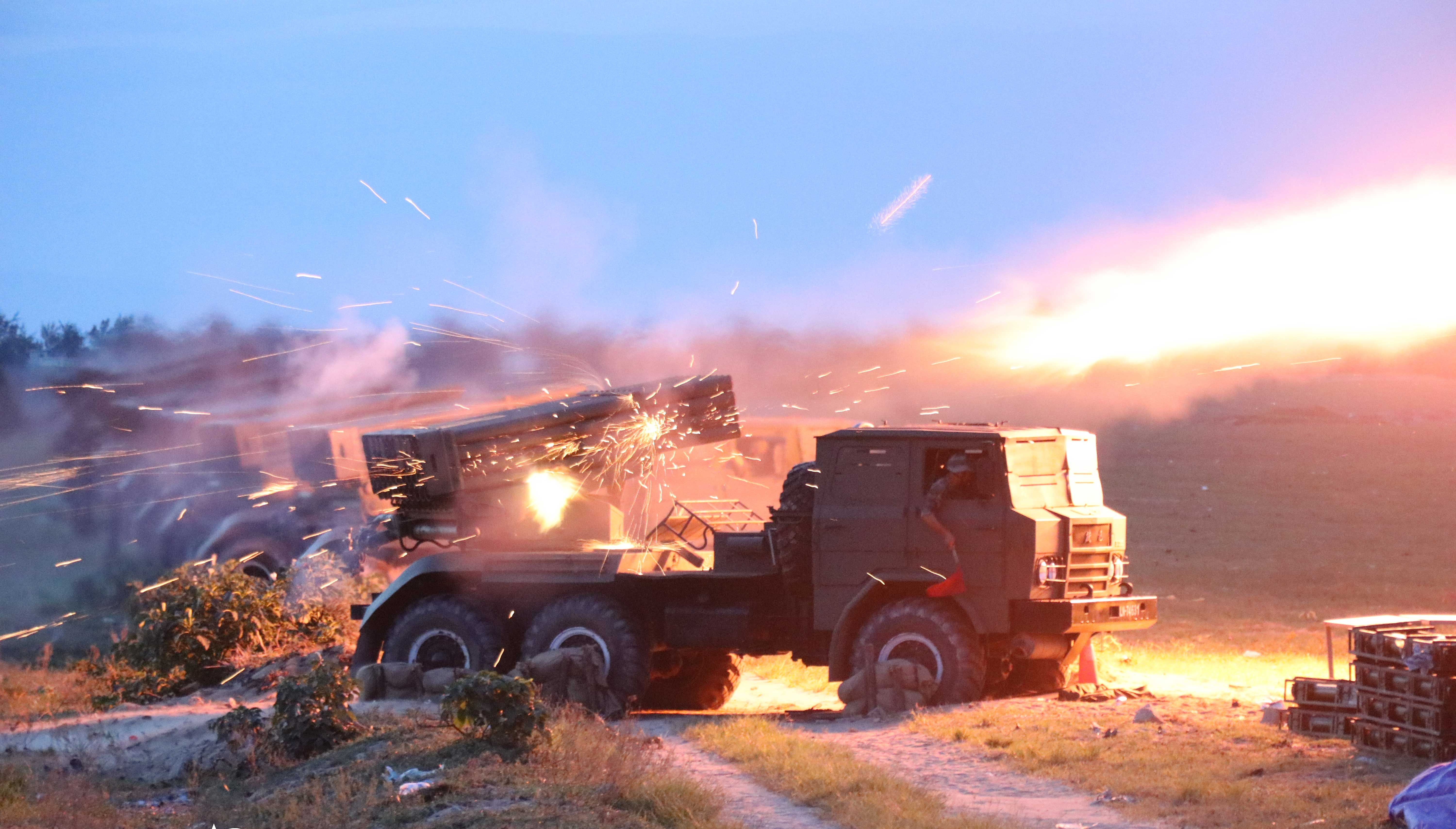 122mm rocket launcher systems fire at mock targets