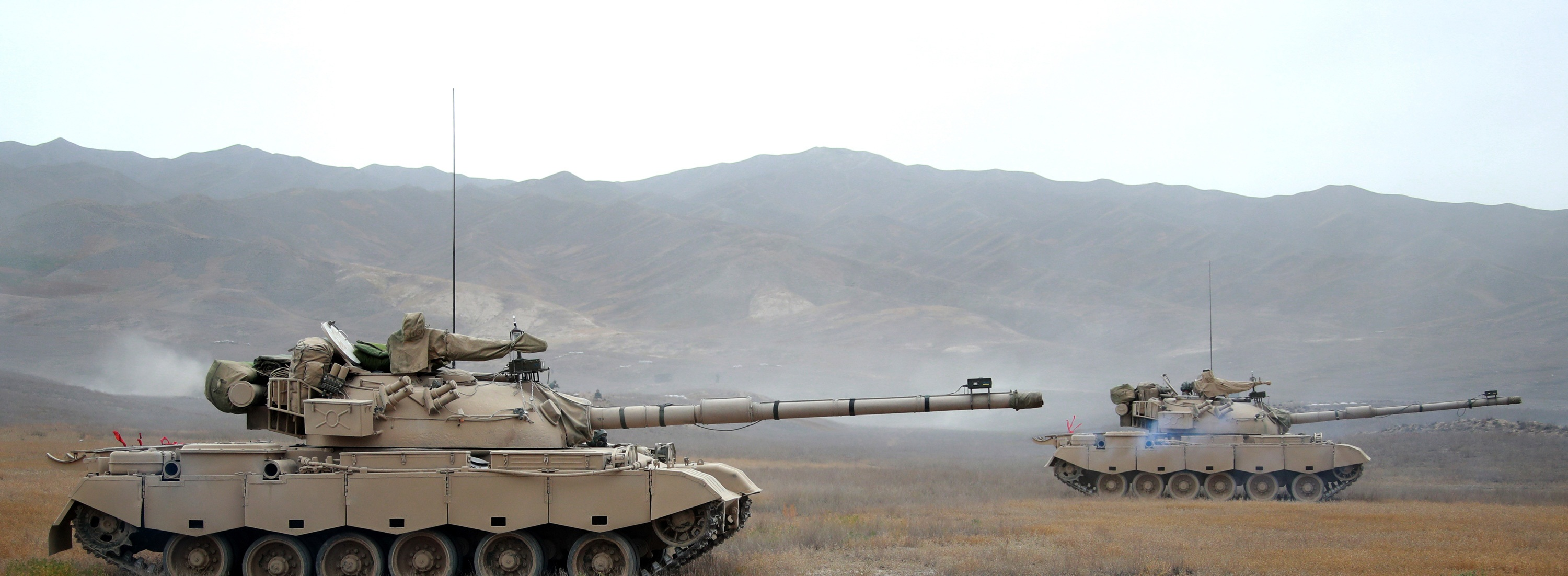 Armored recovery vehicle tows damaged Type-88 MBT during training