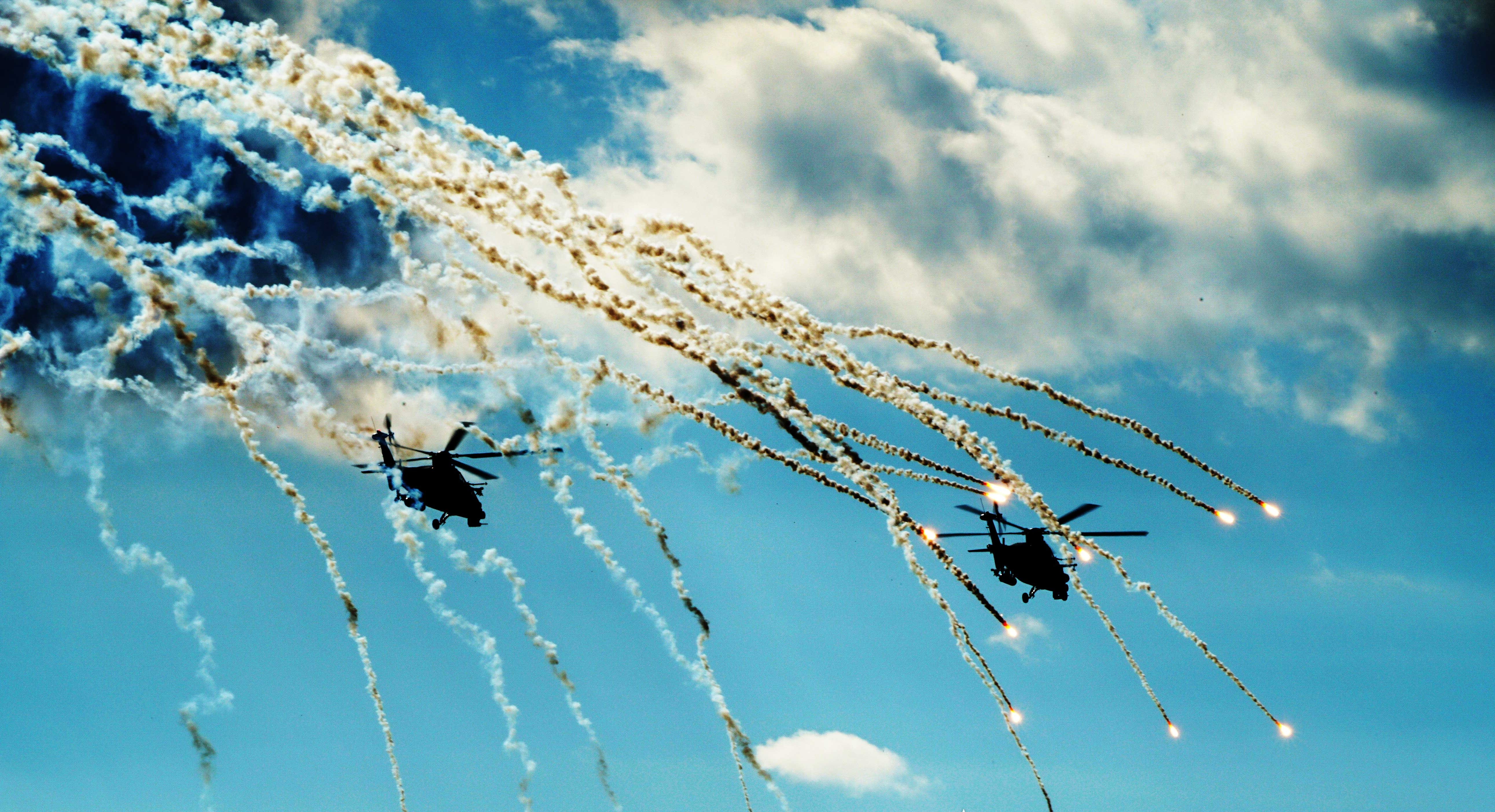 Helicopters expend countermeasure flares