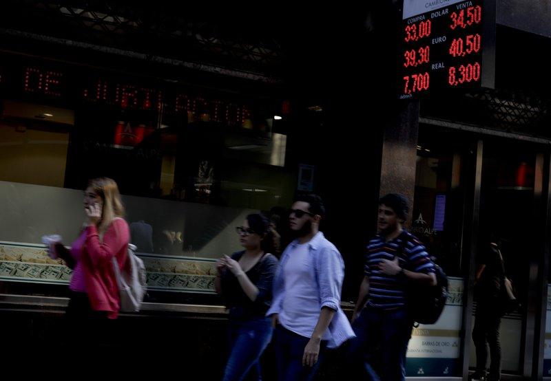 Argentina asks early release of IMF funds to calm markets