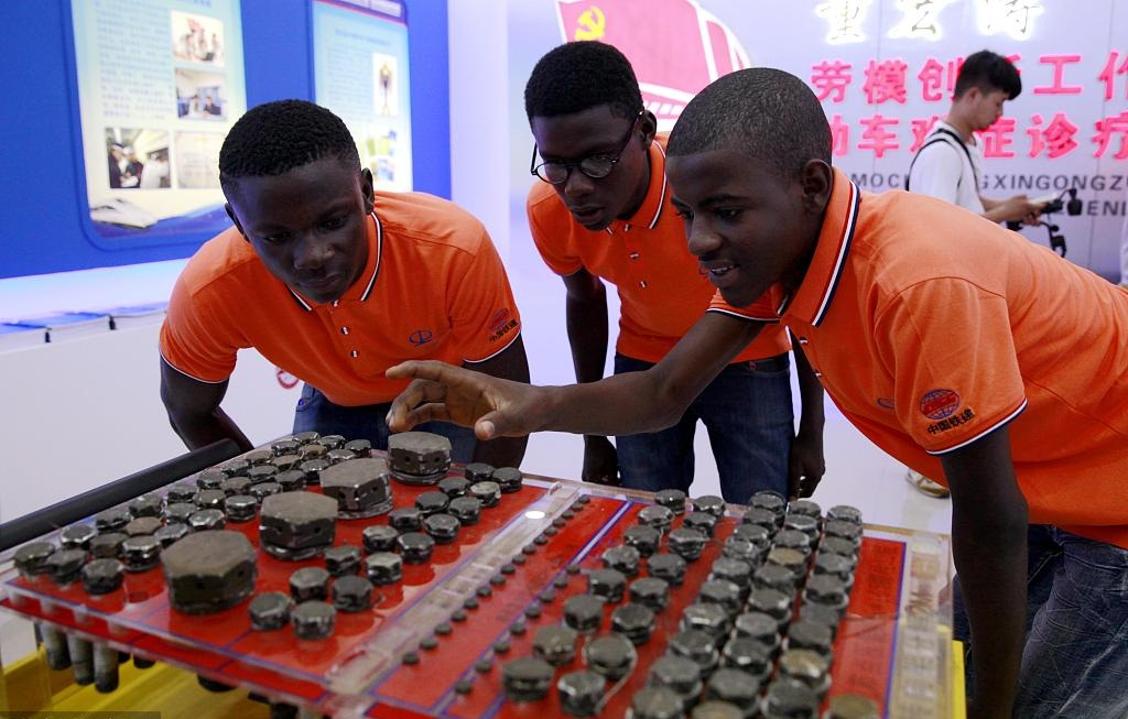 Nigerian students visit largest motor train maintenance base in NW China