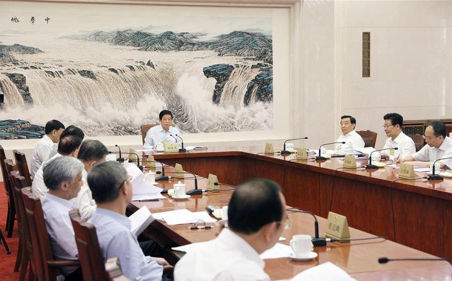 Top legislature hears reports on legal deliberations