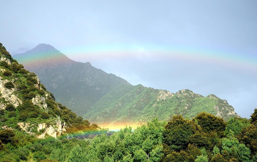 Brilliant double-layer rainbow colors the sky above Tibet