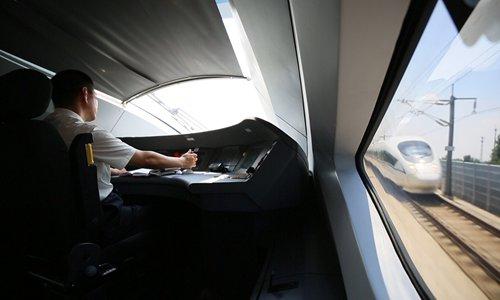 Railway workers recap train development in China since reform of 1978