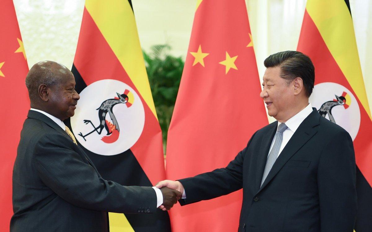 Xi meets Ugandan president