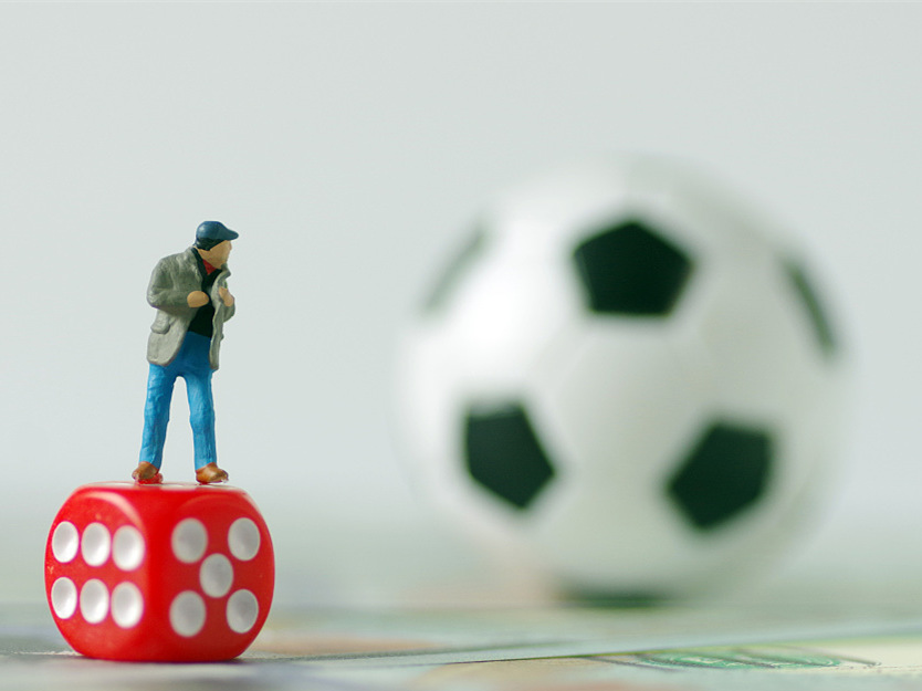 Chinese police arrest 63 for online football gambling