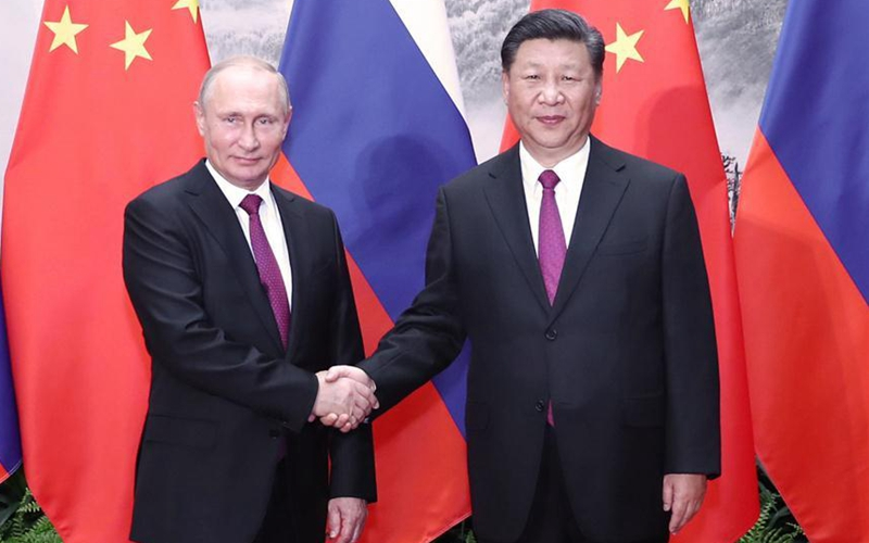 Xi, Putin pledge to enhance bilateral ties, safeguard world peace
