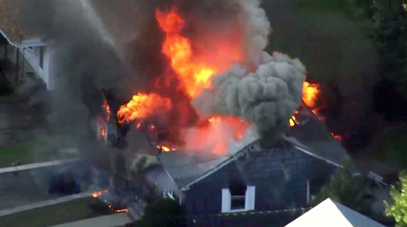 The Latest: Firefighter among injured in Andover fires