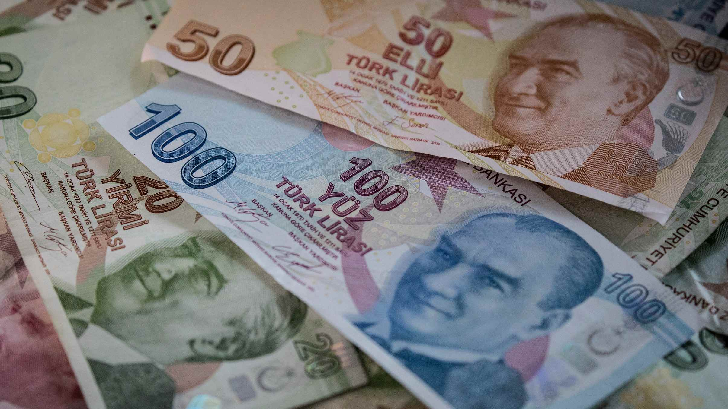 Turkish lira eases after central bank hikes rate