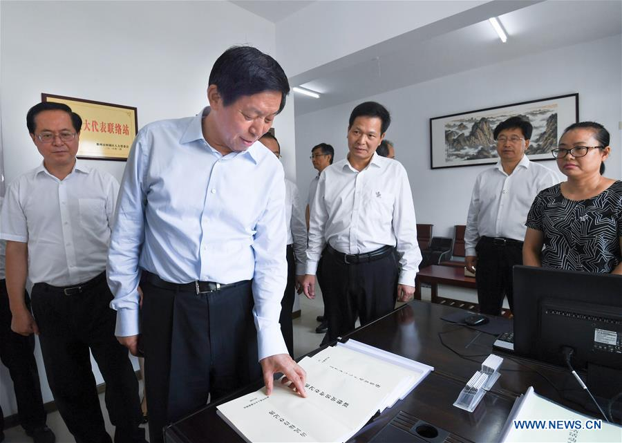Top legislator stresses Xi's thought in advancing local legislation