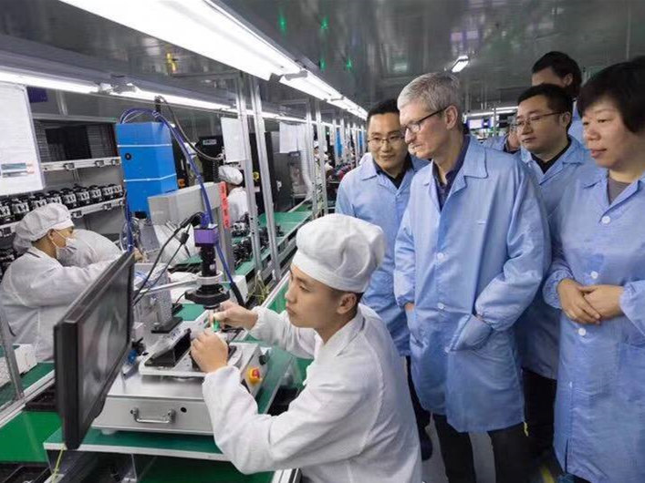 Workers of Apple's Chinese supplier embrace robotic automation