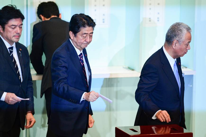 Japan's Abe wins party leadership election: official